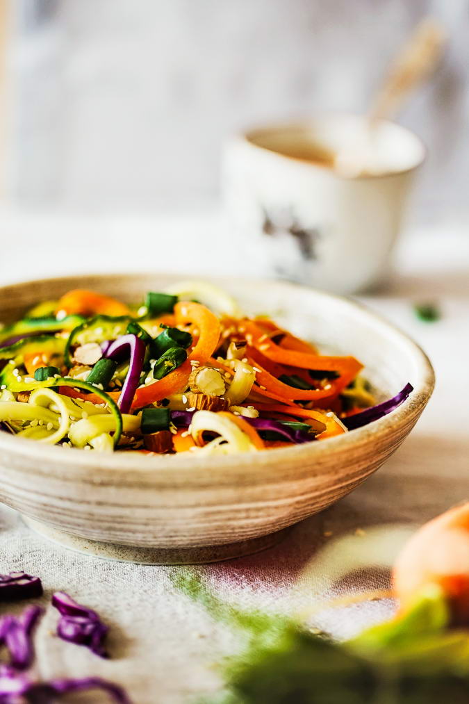 Enjoy these raw rainbow noodles with Thai sauce and you'll be keeping all of the nutrients alive in the vegetables. It's raw eating made easy, fun, and delicious with a colorful assortment of the healthiest veggies.
